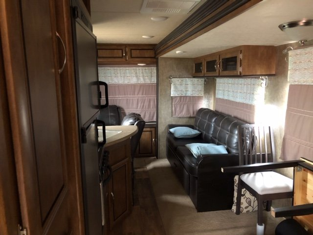 Well taken care of camper. Lots of extras go with this camper. Custom made curtains, LED Lights inside & outside, Ikea table/chairs, Leather couch with 2 recliners.